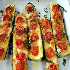 Low carb!  Slice the zucchini in half. Slice off the bottom to keep in stable. Brush with olive oil and top with garlic or garlic powder. Top with sliced tomatoes, salt and pepper to taste. Use mozzarella cheese, Parmesan cheese or mixed blend.. Bake 375 for 20 to 30 minutes until soft.
