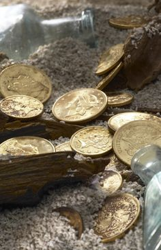 A montage of gold coins recovered from the SS Republic, comprised of Ten Dollar Gold Eagles, and Twenty Dollar Double Gold Eagles.