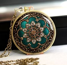 I love the antique look of this locket on Etsy.