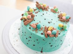 Save this Easter dessert recipe to learn how to make + decorate a Speckled Chocolate Easter Egg Cake.
