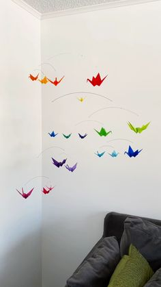 Rainbow Origami Paper Crane Mobile. This mobile has cranes folded from papers in solid colors. It is handmade with care and makes a colorful addition to any room, whether an office at work, a newborn nursery, or any space that needs a little whimsical decor. #rainbowmobile #babygirl #nurserydecor #nurseryinspiration #nurseryinspo #origamimobile #babymobile #nurserymobile baby room, kid's room, baby shower gift, rainbow nursery, nursery ideas, crib mobile, nursery decoration, rainbow baby
