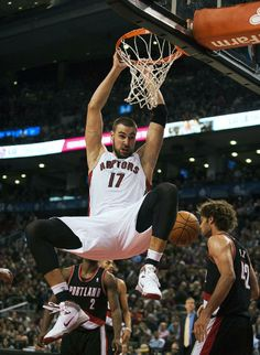 Toronto Raptors Jonas Valanciunas dunks the ball against the Portland Trail Blazers during an NBA basketball game in Toronto on Sunday, Nov. 17, 2013. (AP Photo/The Canadian Press, Aaron Vincent Elkaim)