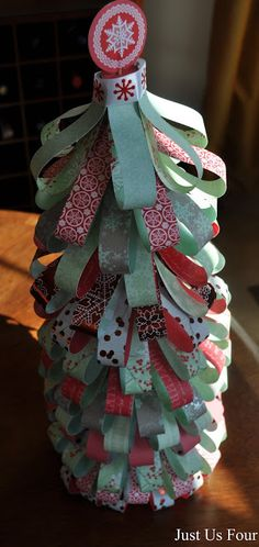 A beautiful and easy to make scrapbook paper Christmas tree! This tutorial has step by step instructions and pictures too!