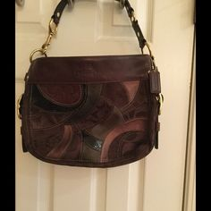 "Coach ""Zoe"" chocolate brown patchwork hobo Top-zip shoulder purse is in excellent condition. Interior is spotless. There are a few minor marks on the leather; however, these are barely noticeable. This beautiful purse features gold hardware,  an interior zippered pocket, and 2 multifunction pockets. Approximately 13"" wide by 10"" long with 8"" strap drop. Coach Bags Shoulder Bags"