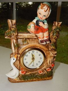 1959 SHEFFIELD Clock W. Germany with Ceramic Case of Girl on Fence RaRe