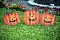 Photo of Three corrugated metal faces that look like pumpkins