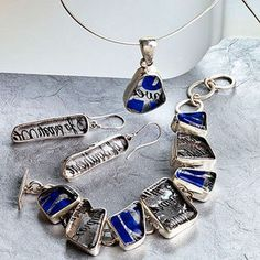 """Bottle Mosaic Jewelry--The artful mosaic of this sparkling collection is distilled from creatively cut bottles. Skilled craftsmen hand polish and set each glass fragment in sterling silver. Matching dangles complement the necklace with 1""""l. pendant and lobster claw clasp and bracelet with toggle clasp. Sterling silver necklace wire and findings."""