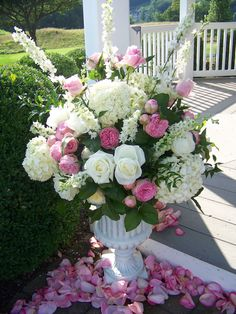 Ceremony decor.  A mix of White and pink flowers ( hydrangeas, roses, peonnies...) in a beautiful white urn.
