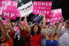People react as Republican presidential candidate Donald Trump speaks during a campaign rally at the MidFlorida Credit Union Amphitheatre on October 24, 2016 in Tampa, Florida. There are 14 days until the the presidential election.