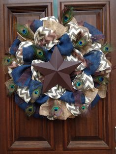 Peacock Star Wreath by Jarabels on Etsy https://www.etsy.com/listing/199189435/peacock-star-wreath