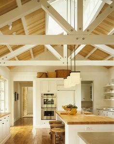 white beams, peak skylight. makes for a beautiful kitchen!