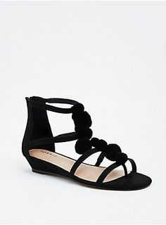 """Are you having fun yet? Not without these sandals, you're not! The black faux suede T-strap, zip back, cage style puts your most fun foot forward with pom poms dotting the strap all over.<div><ul><li style=""""list-style-position: inside !important; list-style-type: disc !important"""">TRUE WIDE WIDTH: Designed so you never have to size up again. For the perfect fit, we recommend going down a whole size.</li><li style=""""list-style-position: inside !important; list-style-type: disc…"""