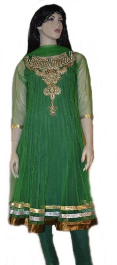 This dark Blue  readymade net churidar Anarkali style kameez is adorned with  stones, zari, patch patti, sequins work. Matching churidar and attractive dupatta comes along with it. Slight variation in color and patch patti is possible. This Anarkali has net sleeves but short sleeves are also provided with the suit that can be stitched on if desired.