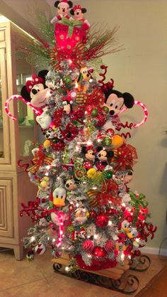 I made my granddaughter a Disney tree. I did it the same way you would make and elf tree. Instead of elfs I use plush Disney characters in all sizes. Wiring them on. I added lighted Walmart candy canes made to be placed in the yard, and lighted packages made to be used as decorations. I also made my own ornaments that you can find on my Christmas board.