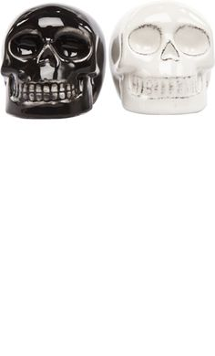 """BLACK & WHITE SKULL SHAKERS        Price:$11.00    What a devilishly lookin' duo we have here! This salt & pepper set include one black skull shaker & one white skull shaker. Add a little scare to your dinnerware!  2 1/2"""" tall"""