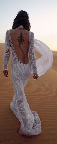 Let alone the fact that this bride, striding up a desert dune, has a Goa'uld skeleton tattooed on her spine... (#Stargate fans take note!) This dress is just amazing. #wordonweddings #bohochic