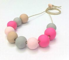 This necklace is made up of 10 clay beads - 3 neon pink, 2 pale pink, 3 grey and 2 tan. These unique beads have been handcrafted and threaded onto 90cm of adjustable natural jewellery twine.    All pieces are one of a kind as they are all individually made to order just for you. Yours may vary slightly in colour and size to the one in the photograph.     Free standard shipping to anywhere within Australia!