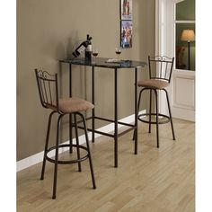 Upgrade the look of your décor with this space saving bar table. This table is made from metal and laminate faux-marble. Featuring adjustable legs and a warm table-top finish, this table is sure to complement any kitchen or dorm room.