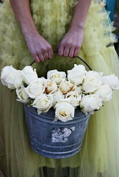 buckets of white roses... Would be cute for country/rustic wedding to have the flower girl pull petals out of this...