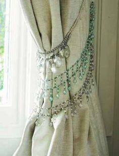 Repurpose your old rhinestone necklaces to make curtain tiebacks for a bohemian-inspired home.   http://interiordecoratinglupe.blogspot.com