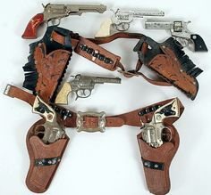 Child's toy guns and holster sets, six pistols.