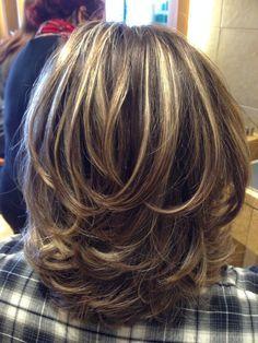Cute medium layered hair cut.