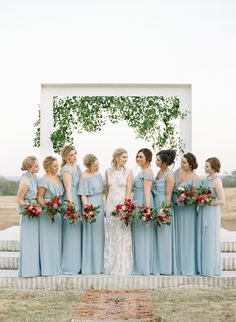 bridesmaids in blue - photo by Sophie Epton Photography http://ruffledblog.com/modern-romantic-wedding-with-boho-details