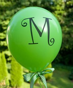 Print letter on full page of clear label paper. Curlz MT is this font. Great way to personalize your graduation party decorations!
