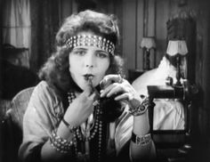 "Olive Thomas applies her lipstick in ""The Flapper""(1920)."