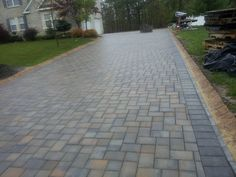 Paver driveway with belgian curbing by www.pyramidrenovations.com  https://www.facebook.com/pages/Pyramid-Renovations-Landscape-Design/124290674270235