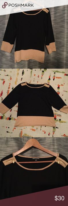 Like new color block sweater Gorgeous black and beige color block sweater with gold zippers on shoulder details.  Very stylish and comfortable.  Has a good amount of stretch but is not clingy.  3/4sleeve. Excellent condition.  Worn once.  Smoke/pet free home. Cable & Gauge Sweaters