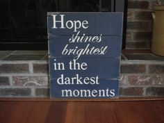 Hope shines brightest in the darkest moments pallet sign handpainted in cream on a rustic navy background via Etsy