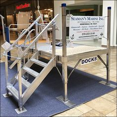 Boat Dock Sales On The Mall Concourse – Fixtures Close Up Pole Holders, Beach Umbrella, Boat Dock, Kayaks, Sale On, Mall, Relax, Swimming, Desk