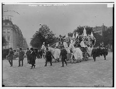 The funeral of the two children of Isadora Duncan in Paris. [4 horses drawing huge ornate hearse.]