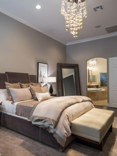 Jonathan Scott's bedroom features a soothing neutral palette that complements the adjoining bathroom, as seen on HGTV's The Property Brothers at Home.