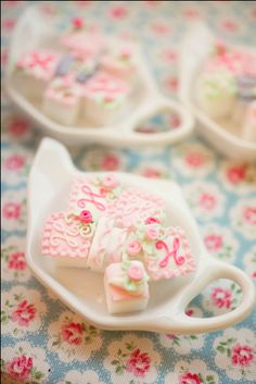 How pretty! Decorated sugar cubes in a plain white tea tidy. What a *great* idea for each place setting at the tea table!