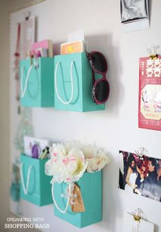 Use shopping bags as wall decor