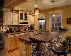 #Rustic #Kitchen - Love the stone facing and rigid counter tops!