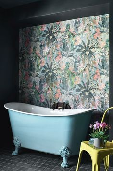 A heritage wallpaper design with a modern colour palette: beautiful jungle foliage, flowers, fruit, birds of paradise in profusion.