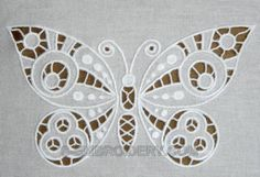 Image from http://www.s-embroidery.com/magazin/images/D/10502_cutworkbutterflydetail.jpg.
