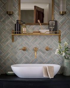 Herringbone wall tiles for awesome #bathroom decor. Love this! #homedecor @istandarddesign