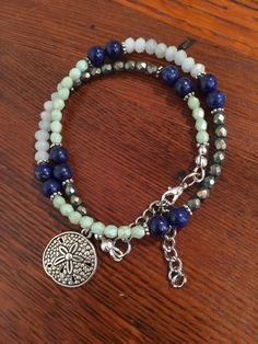 Multi gemstone wrap bracelet with sand dollar charm