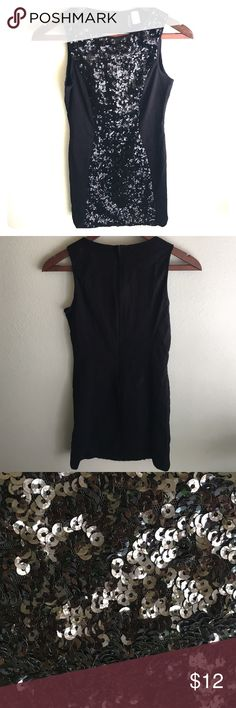 SALE ♥️ Sexy sequenced black dress Short sexy black dress with black sequence and high scooped neckline. Perfect going out dress for a party or down town! Only worn once! H&M Dresses Mini