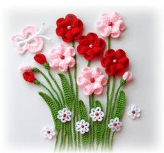 Hand Crochet Appliques flowers and leaves made using Acrylic yarn and finished with wooden or pearl beads. Please note, this is an applique set - the flowers and leaves are not attached to each other so that you may arrange them on your project however you like. Flowers measures