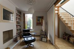 Credit: Michael Franke for the Guardian A sliding panel between the living room and hallway takes up less room than traditional doors and allows the front room privacy when needed. Note the half shutter on the window. Teal Living Rooms, Living Room Windows, New Living Room, Living Room Chairs, Living Area, Dining Room, Victorian Terrace, Victorian Homes, Max S