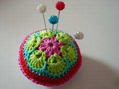 African Hexagon Flower pincushion (website is in German but the pictures are easy to follow) Here's the tutorial with lots of great pictures...  http://heidibearscreative.blogspot.com/2010/05/african-flower-hexagon-crochet-tutorial.html