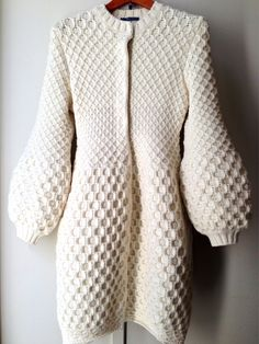 This Alexander McQueen long cardigan seems to have a life of it's own.