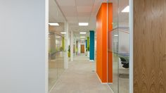 Corporate office design. Corridor in office. Bright branding colours. Expolink office designed by Interaction, UK.