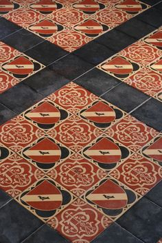 Encaustic floor tiles in the main in entry also bore the family icon.