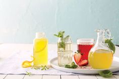 These inventive seasonal simple syrups—crafted for you to keep in the refrigerator all summer long—give iced tea or cocktails an extra-fresh zing. Now ain't that sweet? Mint Syrup Recipe, Lemon Syrup, Syrup Recipes, Drink Recipes, Cocktail Recipes, Rosemary Simple Syrup, Mint Simple Syrup, Southern Recipes, Sweet Recipes